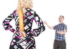 Couple problem. Stereotypical wife with rolling pin and her husb Royalty Free Stock Image