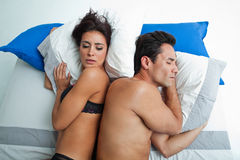 Couple with problems in bed. Heterosexual couple with problems in bed Royalty Free Stock Photography