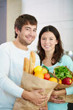 Couple with products Royalty Free Stock Photography