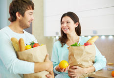 Couple with products Royalty Free Stock Image