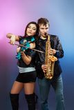 Couple of professional musicians Stock Images