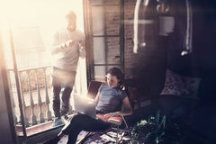 Couple professionals work together. Photo woman and bearded man working with new startup project in modern building Royalty Free Stock Photos