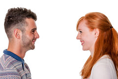 Couple in profile smile at each other Royalty Free Stock Images