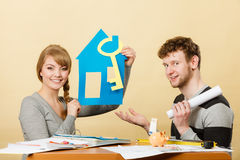 Couple project their first house. Stock Image