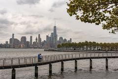 Couple on Promenade with NY City Skyline in Background stock images