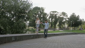A couple promenading in the park. stock footage