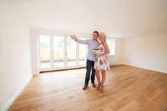 Couple With Property Details Looking Around New Home Royalty Free Stock Images