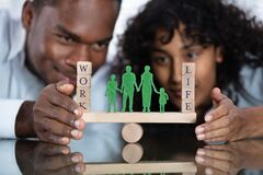 Free Couple Protecting Work And Life Balance On Seesaw Stock Photos - 182261643