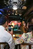 Couple in pub. Couple enjoy live music in pub or bar Stock Images