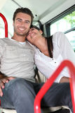 Couple on public transport Royalty Free Stock Photo