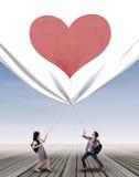 Couple pulling big banner Stock Image