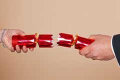Couple pulling a Christmas cracker Royalty Free Stock Photography
