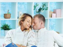 Couple in pullovers Royalty Free Stock Image