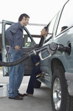 Couple Pumping Gas Into Car stock photography