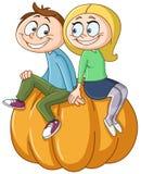 Couple on pumpkin Royalty Free Stock Image