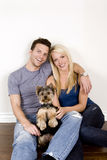 Couple and puppy Stock Image