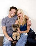 Couple and puppy Royalty Free Stock Photos
