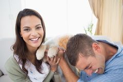 Couple with puppy at home Royalty Free Stock Photos