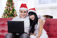 Couple purchase online in christmas day Royalty Free Stock Photo