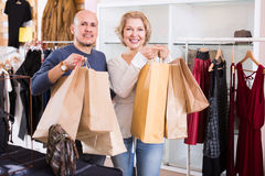 Couple with purchases in bags. At apparel store Stock Photography