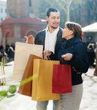 Couple with purchases at city street Stock Photography