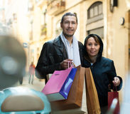 Couple with purchases at street Royalty Free Stock Image