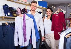 Couple purchasing clothes for two in boutique Royalty Free Stock Images