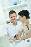 Couple purchasing with credit card Royalty Free Stock Photography