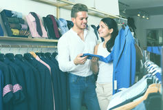 Couple purchasing jacket for man Royalty Free Stock Photo