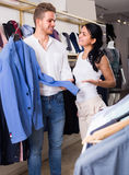 Couple purchasing jacket for man Stock Images