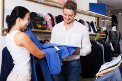 Couple purchasing jacket Stock Photo