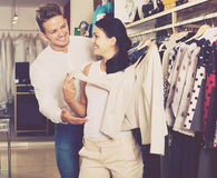 Couple purchasing jacket Royalty Free Stock Photography