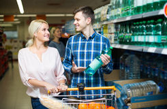 Couple purchasing mineral water Stock Photos