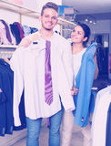 Couple purchasing shirt, jacket Royalty Free Stock Photos