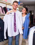 Couple purchasing shirt, jacket Stock Image
