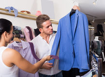Couple purchasing shirt, jacket Stock Photography