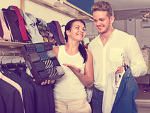 Couple purchasing shirt, tie and jacket at boutique Stock Photo