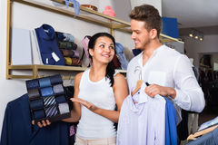 Couple purchasing shirt, tie and jacket at boutique Stock Image