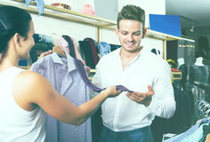 Couple purchasing shirt and tie Royalty Free Stock Photo