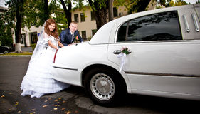 couple pushing white wedding limousine Stock Photo