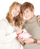 Couple putting five euro in piggy bank Stock Photography