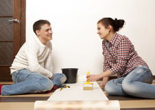 Couple putting new wallpaper Royalty Free Stock Images