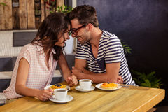 Couple putting their heads together. In the cafe Stock Image