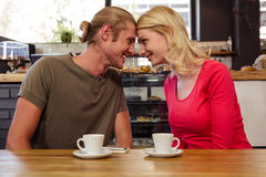 Couple putting their heads together. In the cafe Stock Photography