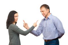 Couple in quarrel. Woman pointing at man, isolated on white background Royalty Free Stock Images