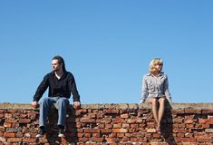 Couple in quarrel. Under the blue sky Royalty Free Stock Photo