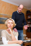 Couple after quarrel indoors Stock Images