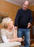 Couple after quarrel indoors Stock Photos