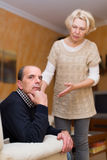 Couple after quarrel indoors Royalty Free Stock Images