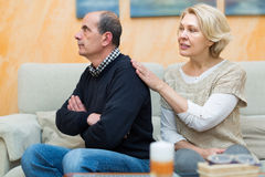Couple after quarrel indoors Stock Photography